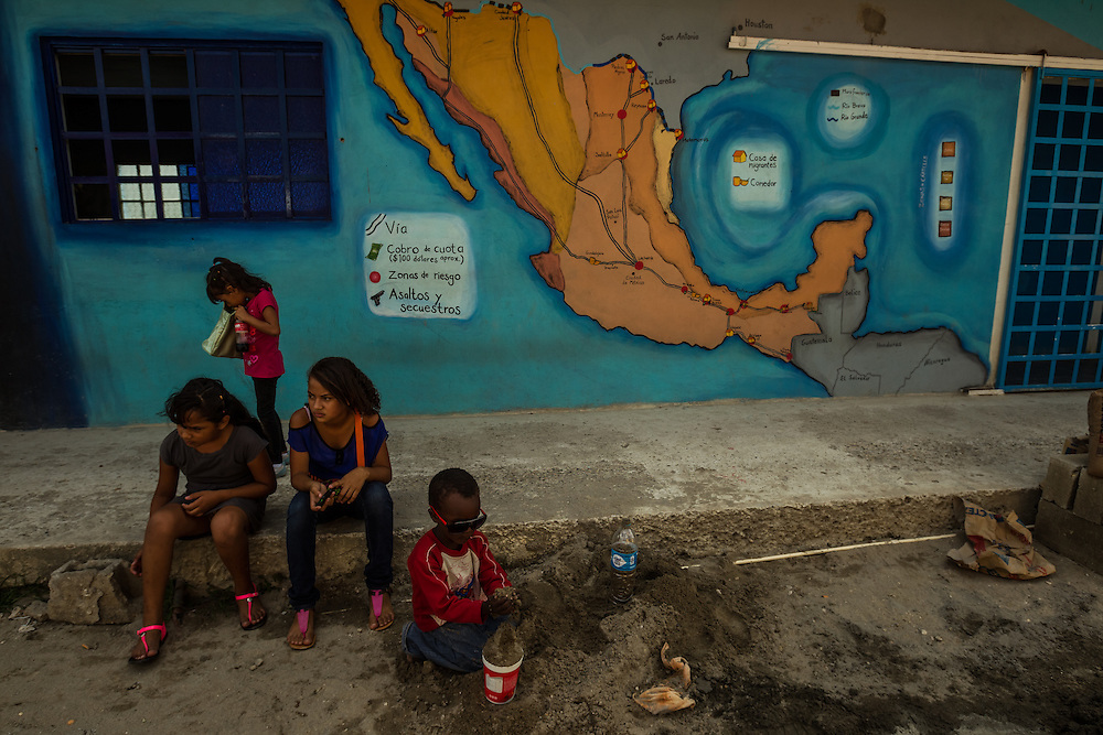 TENOSIQUE, MEXICO - JULY 2, 2014:  Undocumented migrant children play near a map of Mexico at the 72 migrant shelter in Tenosique. Even without official permission to stay, many migrants find an extensive system of church and nonprofit-run shelters helping them and making the journey north possible. PHOTO: Meridith Kohut for The New York Times