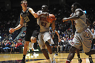 Ole Miss' Reginald Buckner (23) and Texas A&M's Alex Caruso (21) go for the ball in Oxford, Miss. on Wednesday, February 27, 2013. (AP Photo/Oxford Eagle, Bruce Newman)
