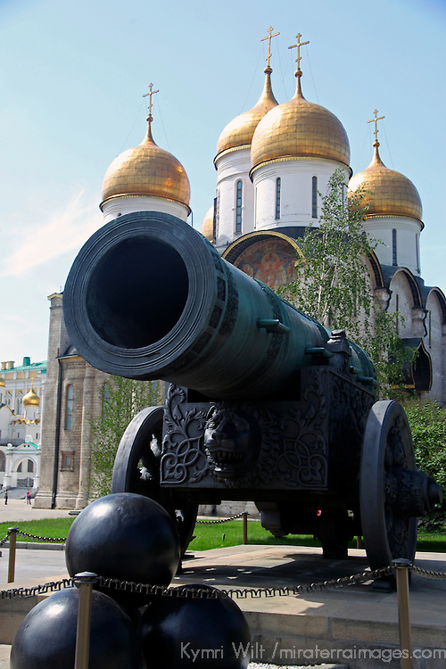 Europe, Russia, Moscow. The Czar Cannon at the Kremlin, with Dormition Cathedral in background.