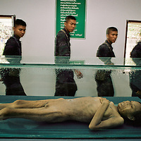 Thailand has taken drastic steps to slow its spread. Thai soldiers learn about AIDS by grim example as they view a victim's body at a hospice run by a Buddhist monastery.