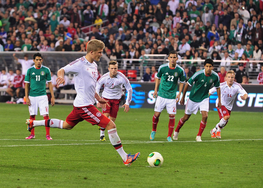 Jan. 30, 2013; Glendale, AZ, USA; Denmark forward Andreas Cornelius (11) shoots to score a goal on a penalty kick during the international friendly match against Mexico in the second half at University of Phoenix Stadium. Mexico and Denmark ended in a 1-1 draw. Mandatory Credit: Jennifer Stewart-USA TODAY Sports