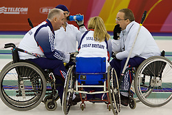 PINEROLO, ITALY - MARCH 15th : Team GBR Frank Duffy, Michael McCreadie, Angie Malone and Tom Killin have a huddle between ends during the last round-robin match of the curling competition between Great Britain and the USA during Day 5 of the Turin 2006 Winter Paralympic Games on March 15th, 2006 at the Pinerolo Palaghiaccio Stadium in Turin, Italy.