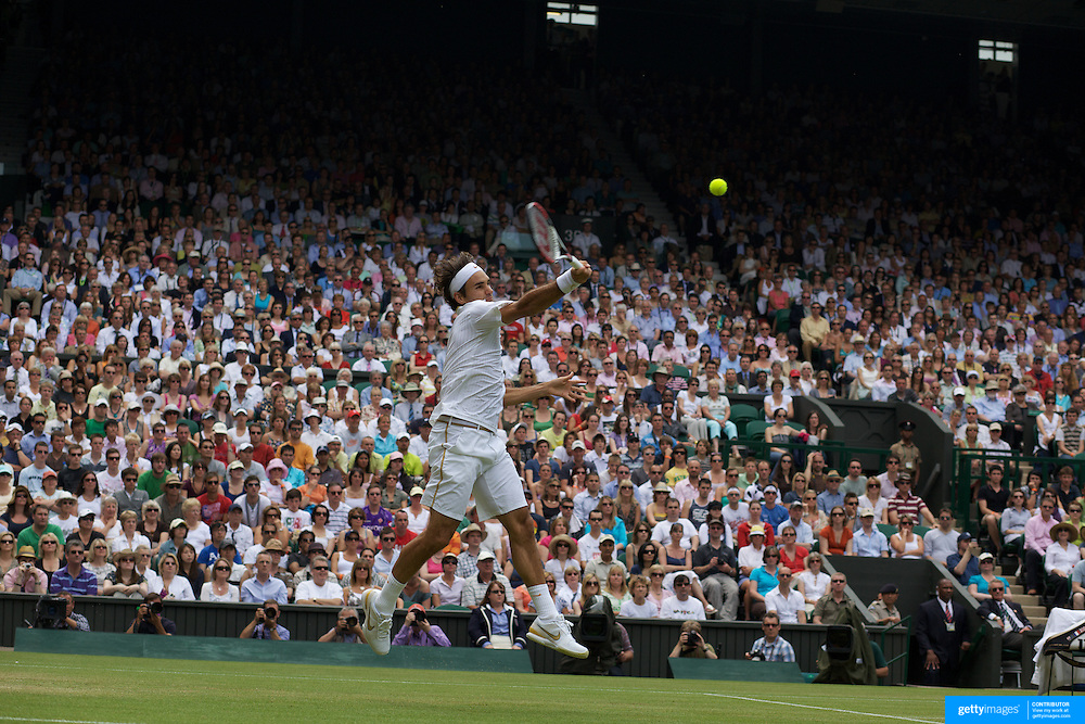 Roger Federer, Switzerland, in action during his victory over Philipp Kohlschreiber, Germany,  on centre court during the third round of the Mens Single competition at the All England Lawn Tennis Championships at Wimbledon, London, England on Friday, June 26, 2009. Photo Tim Clayton.