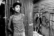 Char outside his home in Los Pinos with his sister. HIs sister is currently living in another part of the slum with their Grandmother.