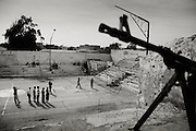 Death or Play. Women&acute;s Basketball in Mogadishu<br /> Women's basketball? In Europa and the U.S., we take it for granted. But consider this: In Mogadishu, war-torn capital of Somalia, young women risk their lives every time they show up to play.<br /> Suweys, the captain of the Somali women&acute;s basketball team, and her friends play the sport of the deadly enemy, called America. This is why they are on the hit list of the killer commandos of Al Shabaab, a militant islamist group, that has recently formed an alliance with the terrorist group Al Qaeda and control large swathes of Somalia.<br /> <br /> Al Shabaab, who sets bombs under market stands, blows up cinemas, and stones women, has declared the female basketball players &bdquo;un-islamic&ldquo;. One of the proposed punishments is to saw off their right hands and left feet. Or simply: shoot them.<br /> <br /> Suweys&acute; team trains behind bullet-ridden walls, in the ruins of the failed city of Mogadishu &ndash; protected by heavily armed gun-men. The women live in constant fear of the islamist killer commandos. Stop playing basketball? Never, they say.<br /> Women&acute;s basketball in the world&acute;s most dangerous capital. Female basketball in Mogadishu, Somalia.<br /> A deadly game..