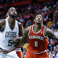 21 December 2012: Milwaukee Bucks center Larry Sanders (8) vies for the rebound with Boston Celtics power forward Kevin Garnett (5) during the Milwaukee Bucks 99-94 overtime victory over the Boston Celtics at the TD Garden, Boston, Massachusetts, USA.