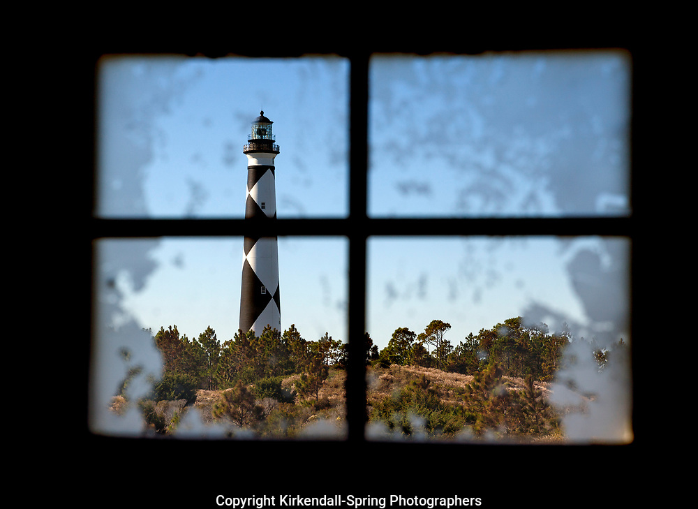 NC00869-00...NORTH CAROLINA - Cape Lookout Lighthouse viewed through a window on the South Core Banks in Cape Lookout National Seashore.
