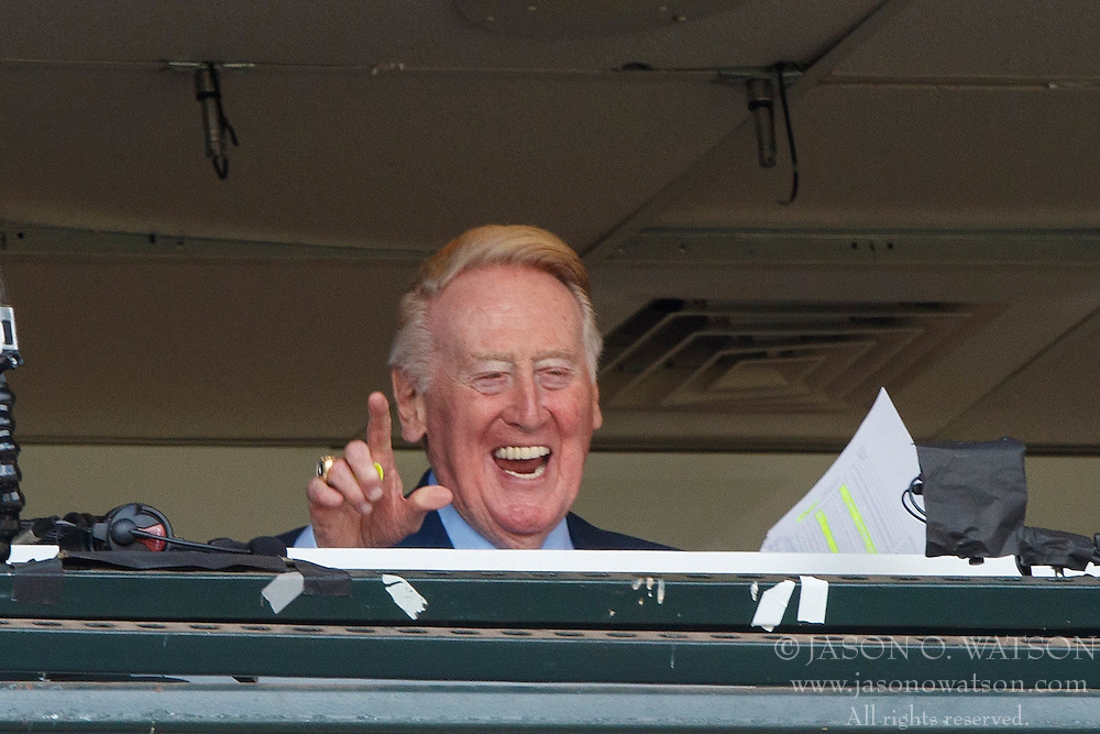 SAN FRANCISCO, CA - OCTOBER 02: Broadcaster Vin Scully waves to fans in the broadcast booth before the game between the San Francisco Giants and the Los Angeles Dodgers at AT&T Park on October 2, 2016 in San Francisco, California.  (Photo by Jason O. Watson/Getty Images) *** Local Caption *** Vin Scully