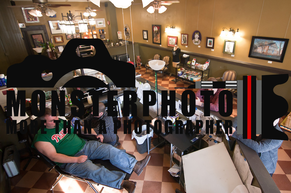 "01/20/11 Wilmington DE: Brain Reamer ""Left"" of Middletown came to Poppycock Tattoo Shoppe to have a previous tattoo covered up. The tattoo work is done by Poppycock owner Pat McCutcheon Thursday afternoon in Wilmington Delaware...Special to The News Journal/SAQUAN STIMPSON"