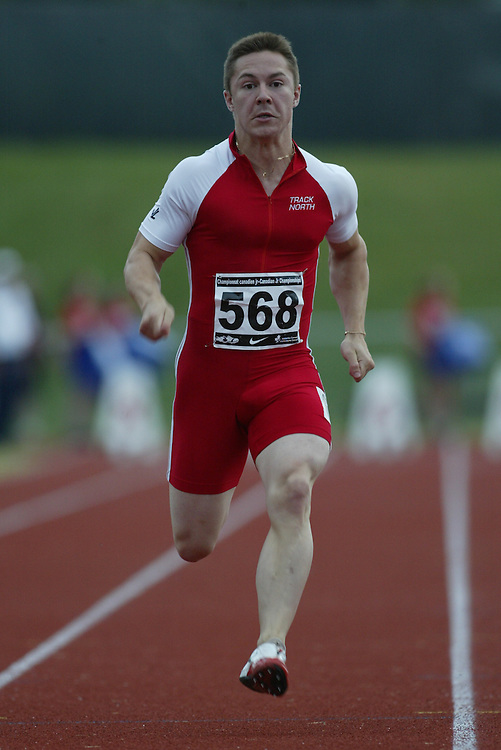 (Charlottetown, Prince Edward Island -- 20090714) Eric Roque of Track North Athletic Club competes in the  100m at the 2009 Canadian Junior Track & Field Championships at UPEI Alumni Canada Games Place on the campus of the University of Prince Edward Island, July 17-19, 2009.  Sean Burges / Mundo Sport Images ..Mundo Sport Images has been contracted by Athletics Canada to provide images to the media.