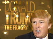 CHICAGO, Il- DEC 7, 2004: Real estate mogul Donald Trump makes an appearance at Chicago's Marshall Field's on State street to promotes his new cologne, The Fragrance. He was joined by 'The Apprentice' winner Bill Rancic.