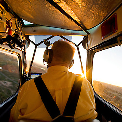 081310       Brian Leddy.Perry Null flies his airplane over Gallup as the sun sets on Friday evening. Null flew over the Gallup Inter-Tribal Ceremonial with a Gallup Independent photographer to document to number of visitors attending Friday's evening performances.