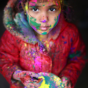 Prama Singh, 5, holds a plate of gulal, or powdred color, during a Holi festival at the Sanatan Dharma Hindu Temple and Cultural Center in Maple Valley on Saturday, March 10, 2012. Holi, the Festival of Colors, is a Hindu festival welcoming spring. It is most well-known for the vibrant bursts of gulal, the powdered dye, that festivalgoers throw on each other. (Joshua Trujillo, seattlepi.com)
