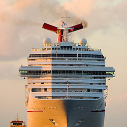 A large cruise ship is in the harbor of Cozumel, Mexico as the sun sets on another warm winter day.