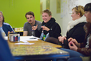 Emily Davidson, gesturing, leads a discussion about artists and workers at the Windsor Workers' Education Centre as part of the MayWorks Windsor 2014 festival. Davidson is from Halix and a Neighbourhood Spaces resident artist.