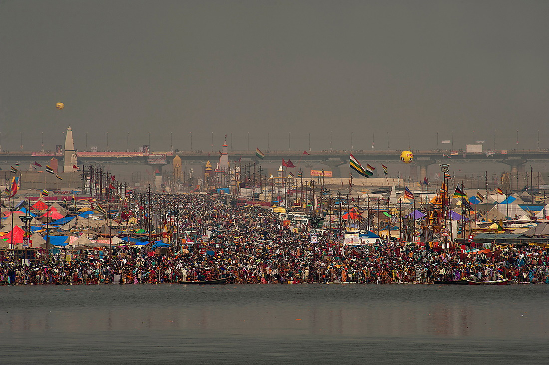 The banks of the sacred river are packed with Hindu pilgrims trying to bathe on February 10, 2013 in Allahabad, India during the Kumbh Mela. This day observes the largest gathering of people in a single day because it is a believed that by bathing on this day a person can acquire good karma which thereby helps pursuing a fruitful and religious life. — © Jeremy Lock/