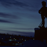 Europe, Norway, Silhouette of miner's sculpture at dusk in arctic coast town of Kirkennes