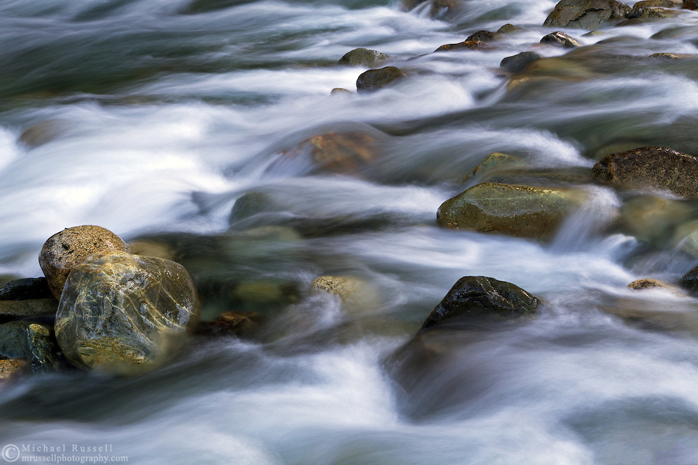 Water flowing around rocks in Gold Creek at Golden Ears Provincial Park in Maple Ridge, British Columbia, Canada