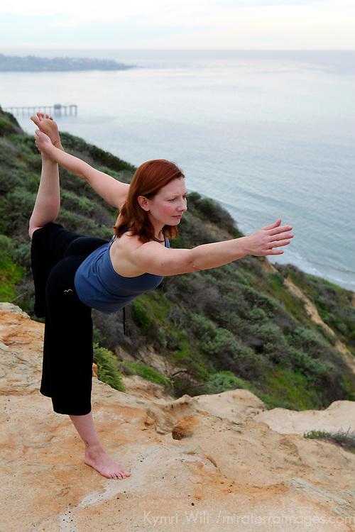 USA, California. Healthy woman in yoga pose outdoors.