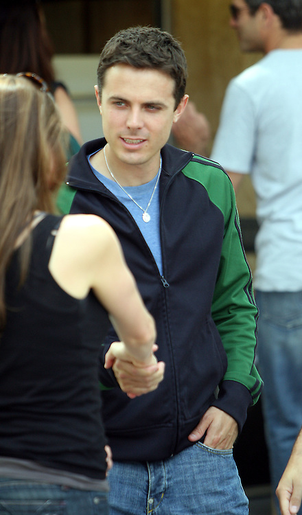 "(06/12/06-Chelsea,MA) Casey Affleck plays hide and seek with his left hand and presumably a wedding ring as he is back on the set for his brother ben's movie ""Gone baby Gone"" after a brief hiatus as he got married to Summer Phoenix.(061206affleckmg-Staff Photo:Mark Garfinkel.saved phto tues/remote)"