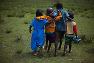 3 year old Saitoti Dickson, second left, Emily Naikada, first right, Janet Naanyie,  first left and 5 year old Lemayian Sanuni, second right, walk back home in the village of Sitoka, in Kilgoris division, Transmara District, Narok County, Kenya Wednesday, Feb. 5, 2014. <br /> Maasai Anglican Pastor and Parent Moses Ntuskosio, speaks on the Maasai belief that children are not considered part of the tribe until they are three years old, &ldquo;The children are not ours, they belong to God. It is God who chooses if they remain. They are not part of the tribe until they are three,&rdquo; though the age differs between the clans. One in eleven children die before their fifth birthday. Awareness is being raised through the mother and child outreach programs on sanitation and nutrition in areas where one third of children are stunted and suffer of chronic malnutrition. Hygiene related diseases are the number one cause of mortality between children under age five, this means they could be prevented with knowledge of basic hygiene and sanitation.