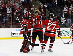 Feb 9, 2009; Newark, NJ, USA; New Jersey Devils left wing Brendan Shanahan (18) and New Jersey Devils defenseman Mike Mottau (27) congratulate New Jersey Devils goalie Scott Clemmensen (35) after his 3-0 shutout win over the New York Rangers at the Prudential Center.