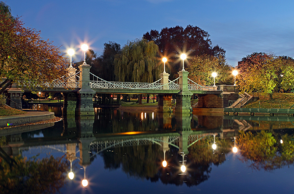 Boston twilight photography of the historic Boston Public Garden Lagoon Bridge photographed on a magical autumn morning in November.<br /> <br /> The bridge crossing the lagoon in the Boston Public Garden was designed by William G. Preston and opened in 1867. It was the shortest functioning suspension bridge in the world before its conversion to a girder bridge in 1921. Nowadays the original suspension system is purely decorative.<br /> <br /> This Boston fall foliage photography picture of the famous Boston Public Garden Lagoon Bridge is available as museum quality photography prints, canvas prints, acrylic prints or metal prints. Prints may be framed and matted to the individual liking and decorating needs:<br /> <br /> http://juergen-roth.artistwebsites.com/featured/lagoon-bridge-in-the-boston-public-garden-juergen-roth.html<br /> <br /> All photographs are available for digital and print use at www.ExploringTheLight.com. Please contact me direct with any questions or request.<br /> <br /> Good light and happy photo making! <br /> <br /> Juergen <br /> www.RothGalleries.com <br /> www.ExploringTheLight.com<br /> http://whereintheworldisjuergen.blogspot.com<br /> @NatureFineArt<br /> https://www.facebook.com/naturefineart