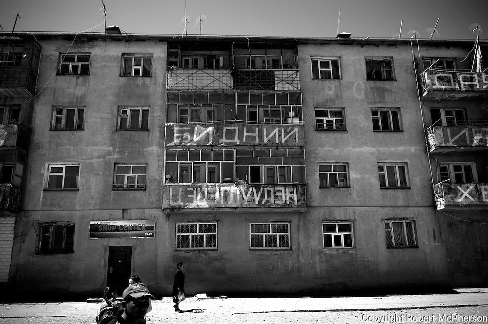 Mongolia(2008). Old apartment block from the Soviet era in Bayan Olgii...Bayan Ulgii town is located in Mongolia`s western-most province. It is set in the Altai mountains where Mongolia,China and Russia converge. It is the only province where Mongolians are not the majority: about 90% of the population are ethnically Kazakh and practise Islamic traditions. Bayan Ulgii town suffered from the collapse of the socialist system; artificially created plants and industries buckled. Suddenly, all services and goods became very expensive. Today, Bayan Ulgii is the poorest province of Mongolia. Maternal and infant mortality rate is much higher than in the rest of the country and the central hospital still use Soviet made equipment waiting to be replaced.
