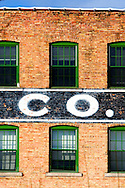 A large, vintage brick factory building with the abbreviation for Company, CO., on the side.