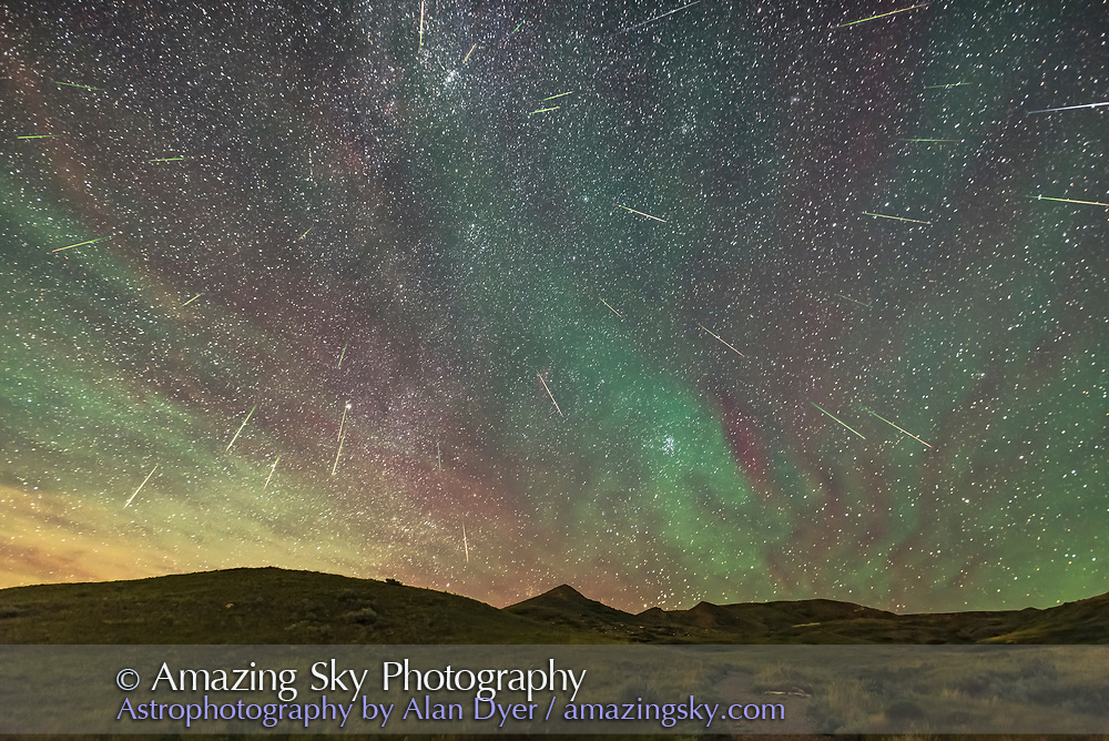 A composite of the Perseid meteor shower, on the peak night, Aug 11/12, 2016, looking northeast to the radiant point in Perseus left of centre, with the Pleiades and Hyades clusters in Taurus rising. There are 33 meteors here. Note the fairly consistent green to red tint of each meteor streak. A couple of streaks look more white and might be flaring satellites though their trajectory matches where a Perseid should be.<br /> <br /> The sky is also filled with bands of red and green airglow which in the time-lapse sequence are moving from south to north, right to left here. The airglow was bright enough that it was visible to the unaided eye as grey bands in the sky, especially the &ldquo;cloud&rdquo; around the Pleiades.<br /> <br /> The reddish/orange patches at upper left are the remains of a long-lived &ldquo;smoke&rdquo; trail from an expoding meteor earlier in the evening, which I of course missed capturing. <br /> <br /> This was taken from the Dark Sky Preserve of Grasslands National Park, Saskatchewan, from the trailhead parking lot at the end of the 70 Mile Butte Road. <br /> <br /> This is a stack of 31 frames containing meteors (two frames had 2 meteors), shot from 1:13 am to 2:08 a.m. CST, so over 55 minutes. So considering the camera would have missed the fainter meteors and is seeing only one section of the sky, 33 meteors over 55 minutes is a great count, translating to perhaps ~ 100 to 150 over the whole sky? This is from latitude 49&deg; N.<br /> <br /> The camera was not tracking the sky but was on a fixed tripod. I choose one frame with the best visibility of the airglow as the base layer. For every other meteor layer, I used Free Transform to rotate each frame around a point far off frame at upper left, close to where the celestial pole would be and then nudged each frame to bring the stars into close alignment with the base layer, especially near the meteor being layered in. This placed each meteor in its correct position in the sky in relation to the stars, essential for showing the effect of the radiant point accurately.