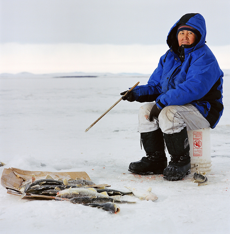 A woman tom cod fishing in Kivalina, Alaska. 2007