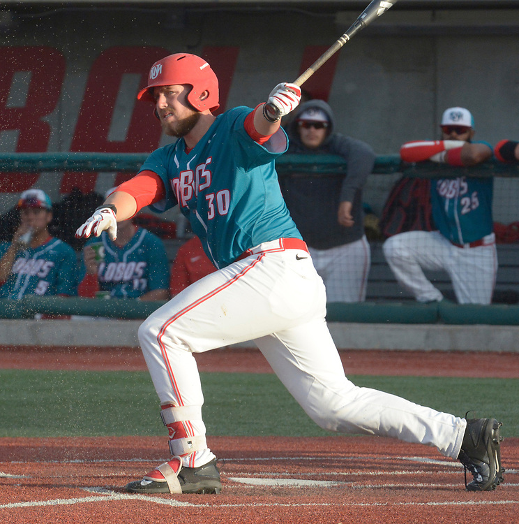 gbs041317c/SPORTS --  UNM third baseman Carl Stajduhar  watches his hit during  the game against Missouri State at the Santa Ana Star Field on Thursday, April 13, 2017. (Greg Sorber/Albuquerque Journal)