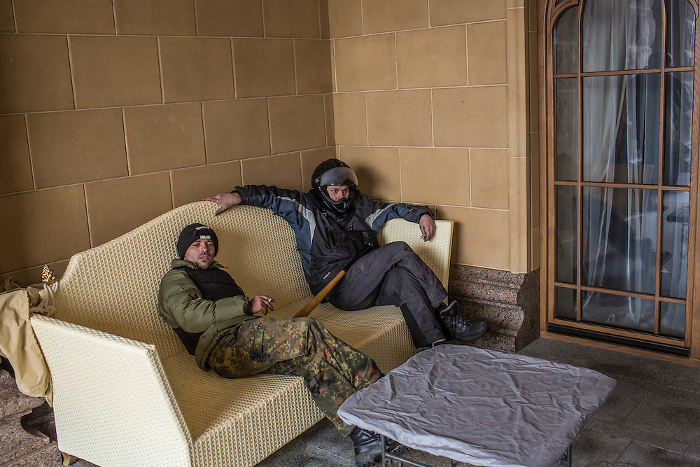 KIEV, UKRAINE - FEBRUARY 22: Anti-government protesters sit on a couch on a back patio at President Viktor Yanukovych's Mezhyhirya estate, which was abandoned by security, on February 22, 2014 in Kiev, Ukraine. After a chaotic and violent week, protesters took control of Kiev as President Viktor Yanukovych fled the city amid calls for his immediate resignation. (Photo by Brendan Hoffman/Getty Images) *** Local Caption ***