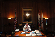 San Francisco Mayor Gavin Newsom sits at his desk inside City Hall in San Francisco on Wednesday August 4, 2004.  Newsom has become a national celebrity after just months in office, owing to his decision to marry gay couples ahead of the Massachusetts legalization. (Globe Photo / Jakub Mosur)