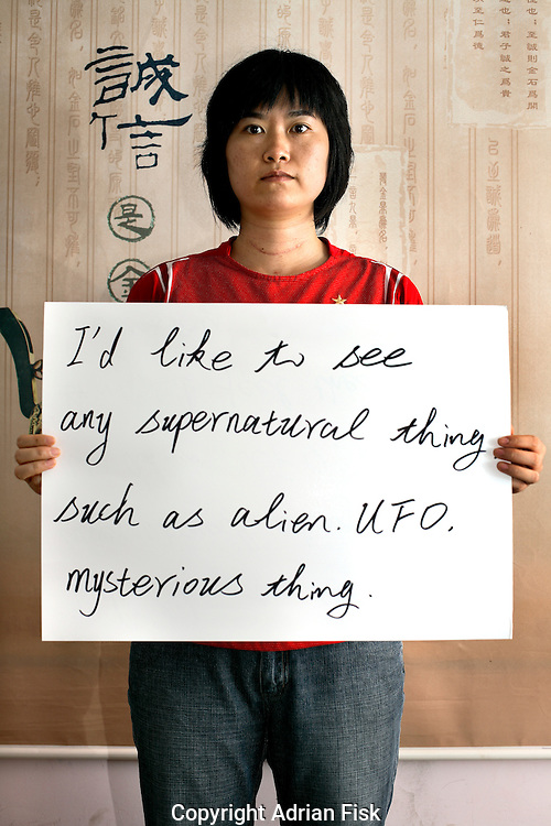 Chan Jie Fang - 28 Yrs.<br /> Supervisor in bag making company in Guangdong Province but learning english in Guangxi Province.<br /> <br /> 'I'd like to see any supernatural thing, such as alien, UFO, mysterious thing'..