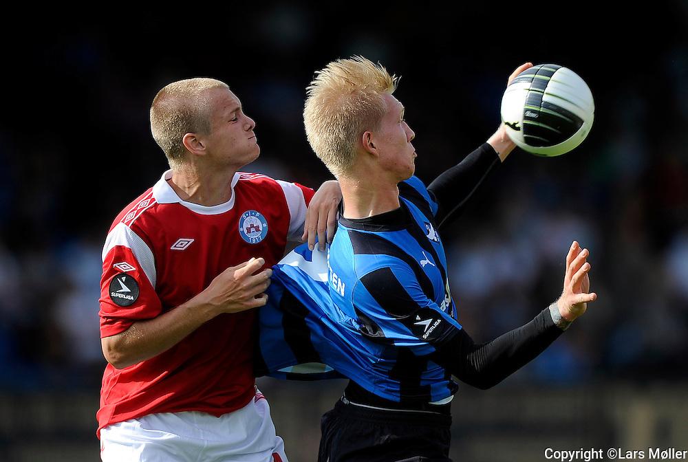 DK Caption:<br /> 20110821, K&oslash;ge, Danmark:<br /> Superliga fodbold, HB K&oslash;ge - Silkeborg:<br /> Simon Jakobsen, Silkeborg IF/SIF, Simon Makienok <br /> Foto: Lars M&oslash;ller<br /> <br /> UK Caption:<br /> 20110821, Koege, Denmark:<br /> Superleague football  HB Koege - Silkeborg:<br /> Simon Jakobsen, Silkeborg IF/SIF, Simon Makienok <br /> Photo: Lars Moeller
