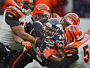 In the second quarter, the Denver Broncos Tatum Bell (#26, RB) is stopped short of the goal line by the Cincinnati Bengals (left to right) Caleb Miller (#58, LB), Brain Simmons (#56, LB) , Madieu Williams (#40, S) and Landon Johnson (#59, LB) at Invesco Field at Mile High on Sunday December 24, 2006. The game will go a long way in determining who makes the playoffs in the AFC. The Broncos would go on to score on the drive..(MARC PISCOTTY/ © 2006)