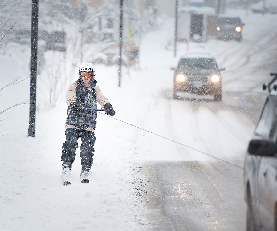 Quest student Nate Spitz gets a ski tow behind a truck up Mamquam Road above Quest University during a winter snowstorm.