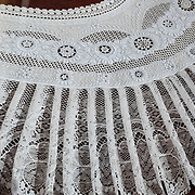 Traditional lace costumery in Appenzell Museum, Switzerland, Europe. Appenzell Museum, which is in the town hall, shows a cross section of the Swiss Canton's history and culture. Appenzell village is in Appenzell Innerrhoden, Switzerland's most traditional and smallest-population canton (second smallest by area).