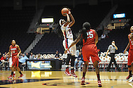 "Ole Miss' Danielle McCray (22) vs. Lamar's Dominique Edwards (25) in women's college basketball at the C.M. ""Tad"" Smith Coliseum in Oxford, Miss. on Monday, November 19, 2012.  Lamar won 85-71."