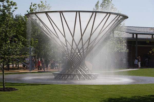 Stock photo of The Mist Tree fountain on a hot afternoon