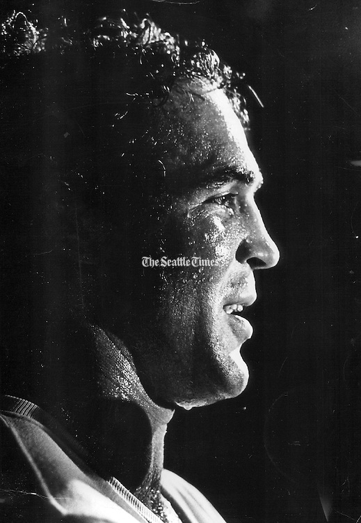 Boone Kirkman was silhouetted by lighting as he prepared for a bout with Preacher Lewis at the Seattle Center Arena, in 1973. (Greg Gilbert / The Seattle Times)