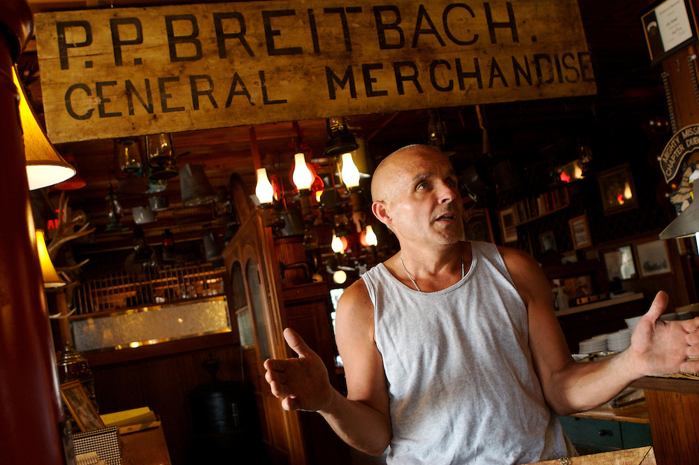 Owner Mike Breitbach talks with visitors at Breitbach's Country Dining in Balltown, Iowa. Breitbach is the sixth generation owner of the bar/restaurant Photo by Scott Morgan