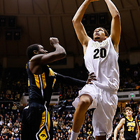 WEST LAFAYETTE, IN - JANUARY 27: A.J. Hammons #20 of the Purdue Boilermakers goes up to dunk against Anthony Clemmons #5 of the Iowa Hawkeyes at Mackey Arena on January 27, 2013 in West Lafayette, Indiana. Purdue defeated Iowa 65-62 in overtime. (Photo by Michael Hickey/Getty Images) *** Local Caption *** A.J. Hammons; Anthony Clemmons