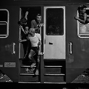 At the Köszke's train station, Hungary, refugees wait by night for the departure of their train chartered by the hungarian authorities, in order to reach to the austrian border, on september 14, 2015. According to the new hungarian laws, refugees cannot cross the border anymore, excepting in specific control points, otherwise, they will be considered as illegal and will be detained or accompanied back to the border they crossed.