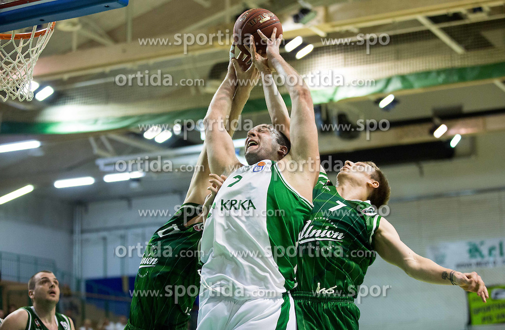 Jure Lalic #7 of Krka between Sasa Zagorac #17 of KK Union Olimpija Ljubljana and Gregor Hrovat #7 of KK Union Olimpija Ljubljana during basketball match between KK Krka and KK Union Olimpija Ljubljana in 5th Round of Nova KBM Champions League 2015/16, on April 13, 2016 in Sports hall Leon Stukel, Novo mesto, Slovenia. Photo by Vid Ponikvar / Sportida