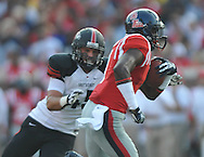 Mississippi's Laquon Treadwell (1) is chased by Southeast Missouri State's Andy McNeel (45) at Vaught-Hemingway Stadium in Oxford, Miss. on Saturday, September 7, 2013. (AP Photo/Oxford Eagle, Bruce Newman)