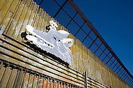 Migration-themed artwork hangs on the fence separating the United States and Mexico in Nogales, Sonora, Mexico, on Thursday, Jan. 31, 2008.