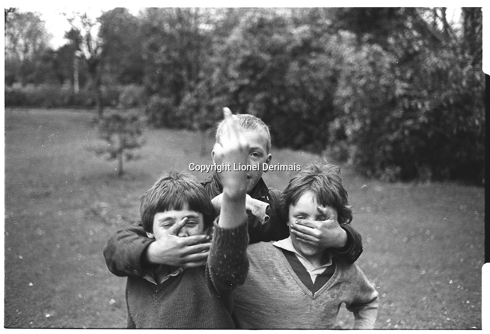 3 kids playing in Greenwich park, London street photography in 1982. Tri-X