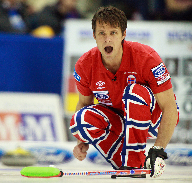 Norway's skip Thomas Ulsrud shouts directions to his teammates during Norway's 7-6 win over Canada in the evening draw at the Ford World Men's Curling Championships at the Brandt Centre in Regina, Saskatchewan, April 7, 2011.<br /> AFP PHOTO/Geoff Robins